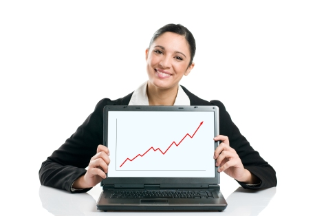 Young business woman displaying successful growing graph on her